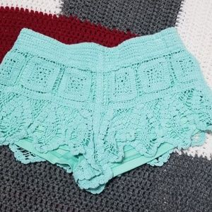 Surf Gypsy crochet aqua blue shorts. Sz M